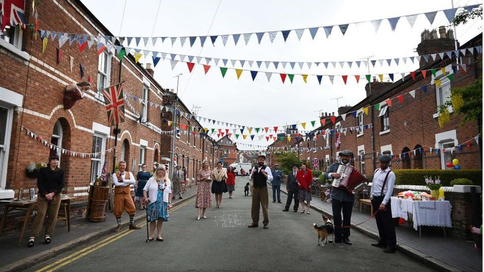 Residents of Cambrian Road dressed up in period costume take part in a street party to mark the 75th anniversary of VE Day in Chester on May 8, 2020