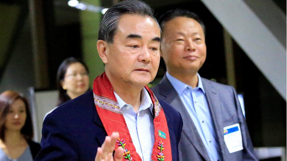 "People""s Republic of China Foreign Minister Wang Yi gestures as he is escorted by Zhao Jianhua, Chinese ambassador to the Philippines, upon arrival at the international airport of Pasay to attend the 50th ASEAN Foreign Ministers meeting, metro Manila, Philippines August 5, 2017"