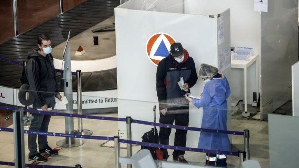 Arrivals at Charles de Gaulle Airport are checked.