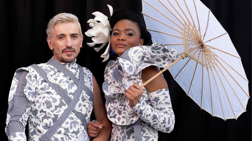 Local fashionistas George Lambrou (L) and Goodness Anele (R) pose for a portrait during the 2018 edition of the Vodacom Durban July in Durban, on July 7, 2018.