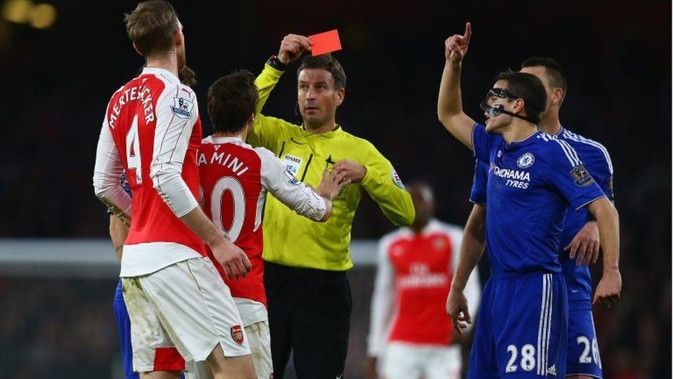 Per Mertesacker of Arsenal is shown the red card and is sent off for his challenge on Diego Costa of Chelsea