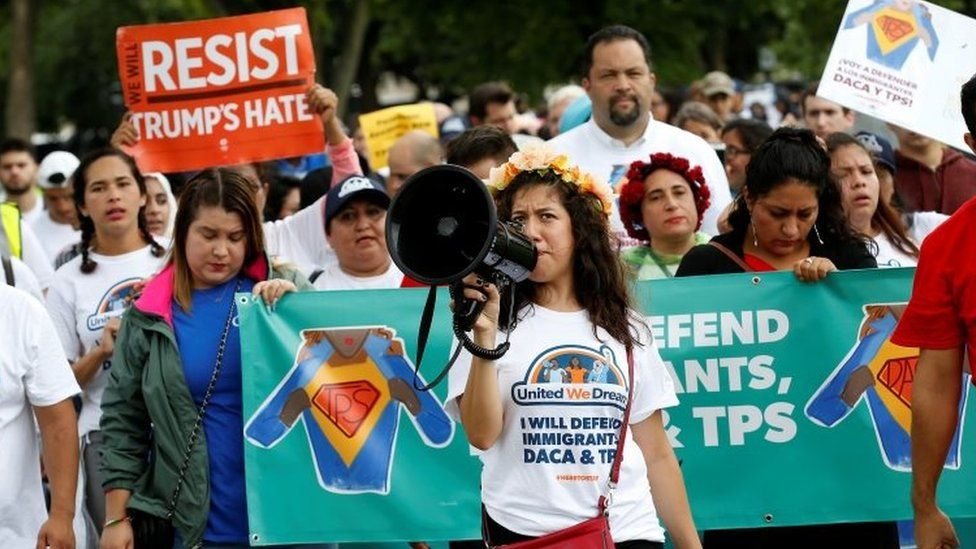 Demonstrators carrying signs march during a rally by immigration activists CASA and United We Dream demanding the Trump administration protect the Deferred Action for Childhood Arrivals (DACA) program and the Temporary Protection Status (TPS) programs, in Washington, U.S., August 15, 2017.