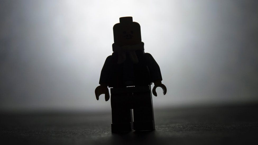 Lego figure in silhouette