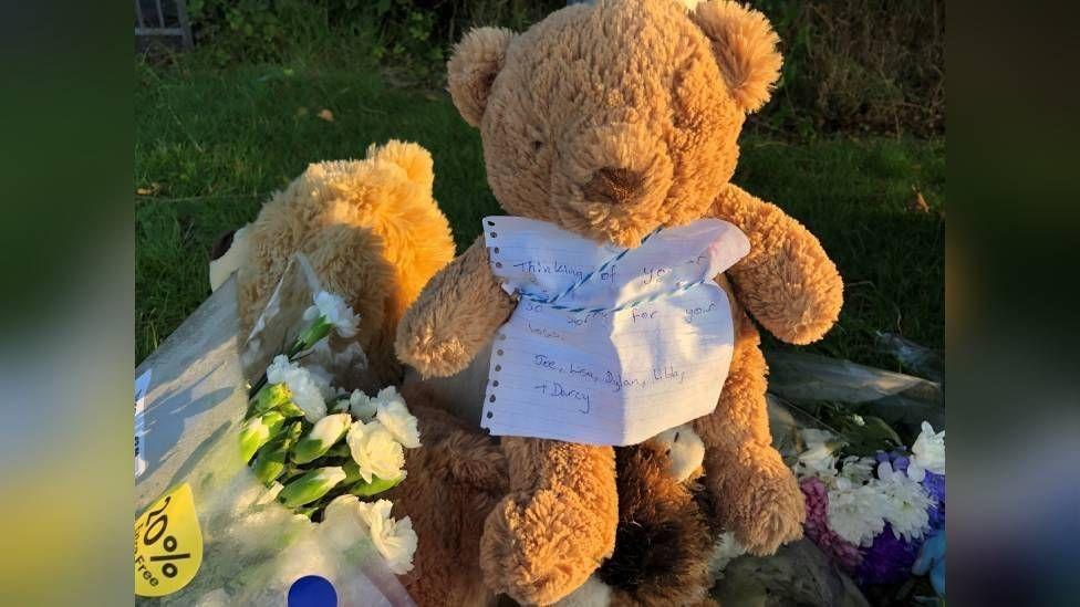 Teddy bear with handwritten note