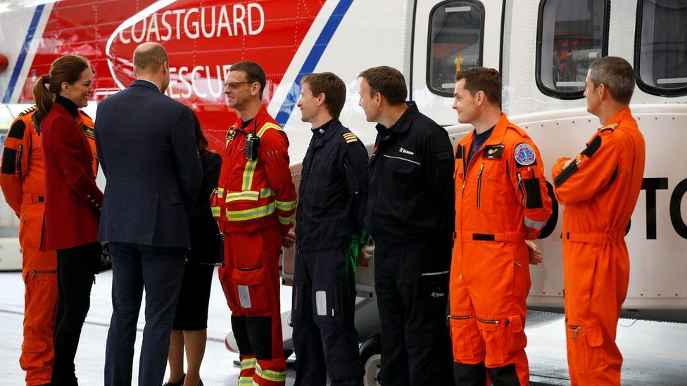 Duchess and Duke of Cambridge with search and rescue staff
