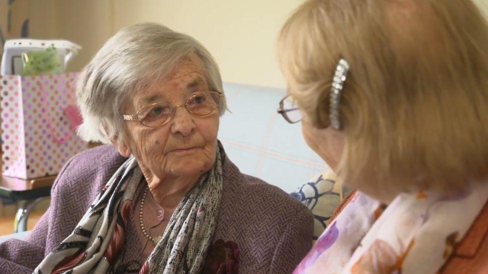 Gladys Vautier speaking to Pauline Botting