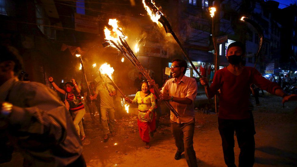 Tharu activists take part in a torch rally protesting against the proposed six provincial demarcations to be included on the new constitution, in Kathmandu, Nepal August 11, 2015