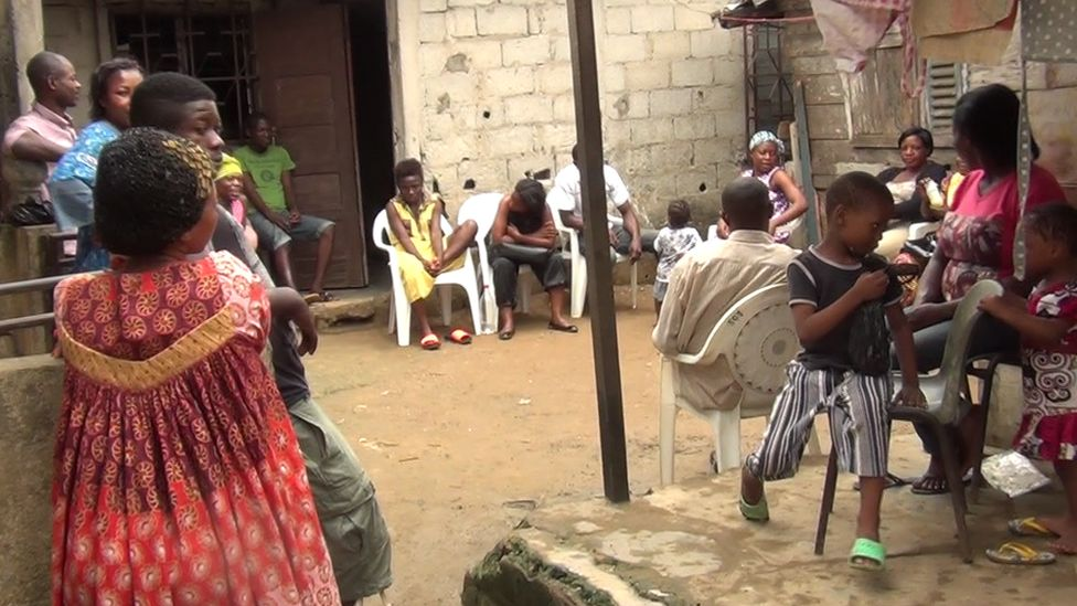 Mourners at Monique Koumateke's house in Douala, Cameroon