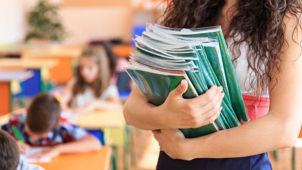 Teacher holding books