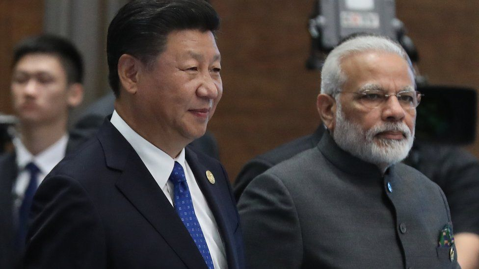 Chinese President Xi Jinping and Indian Prime Minister Narendra Modi attend the Dialogue of Emerging Market and Developing Countries on the sidelines of the 2017 BRICS Summit in Xiamen, south-eastern China's Fujian Province on September 5, 2017