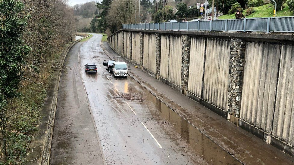 Two cars being recovered on the A470 Dolgellau bypass in Gwynedd following flooding
