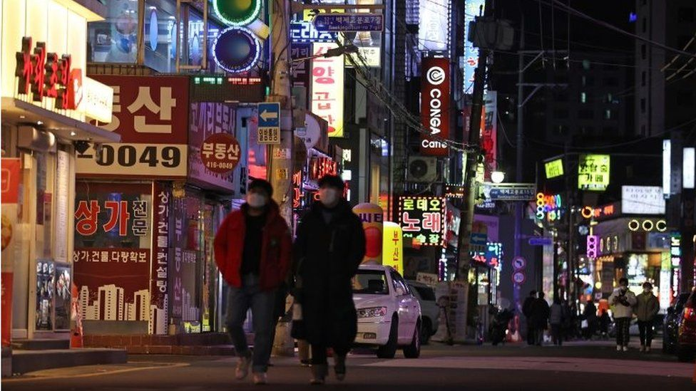 Cafes, restaurants and karaoke rooms are open late at night on a street in Seoul, South Korea, 15 February 2021