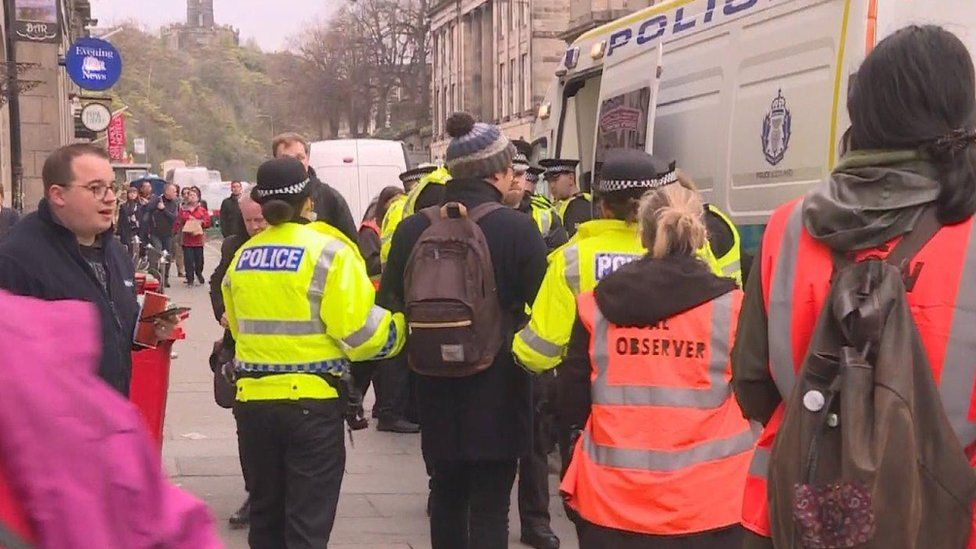 protesters being led away be police