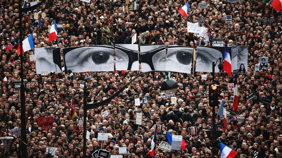 Demonstrators make their way along Boulevard Voltaire in a unity rally in Paris following the terrorist attacks in January 2015