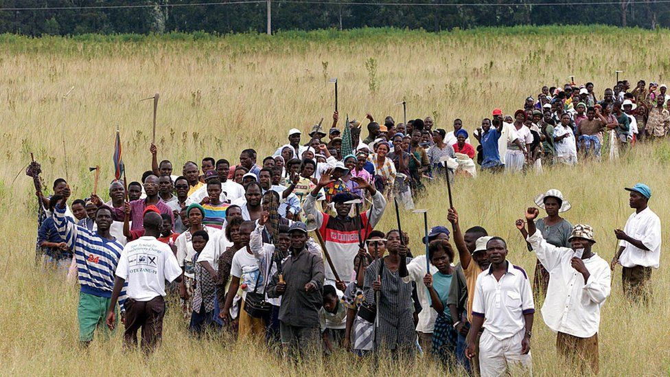 Zimbabweans staging a land invasion