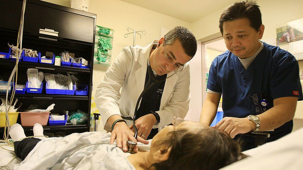 A doctor and a nurse treat a woman in Panorama City, California.