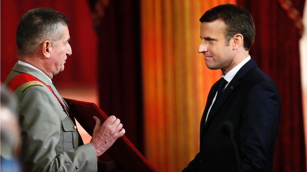 Emmanuel Macron (R) is presented the great chain of office of France's National Order of the Legion of Honour at the Elysee presidential Palace on 14 May 2017 in Paris.