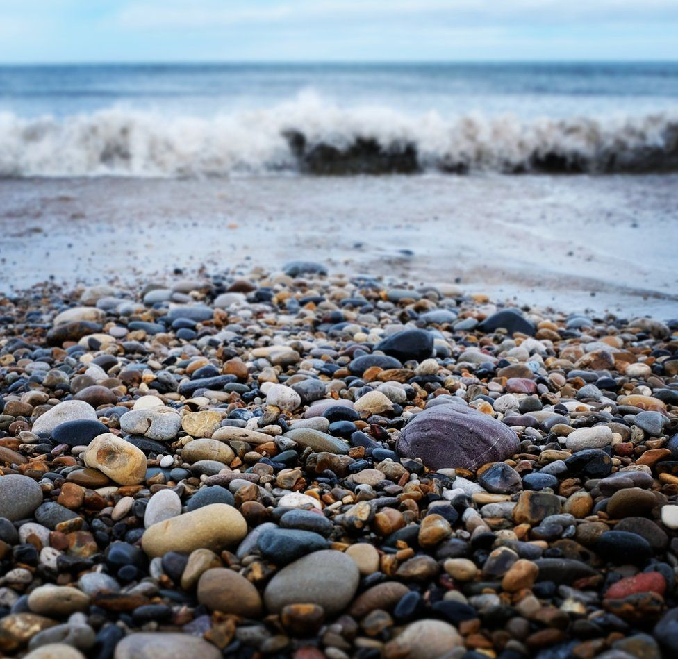 Waves crashing on pebbles