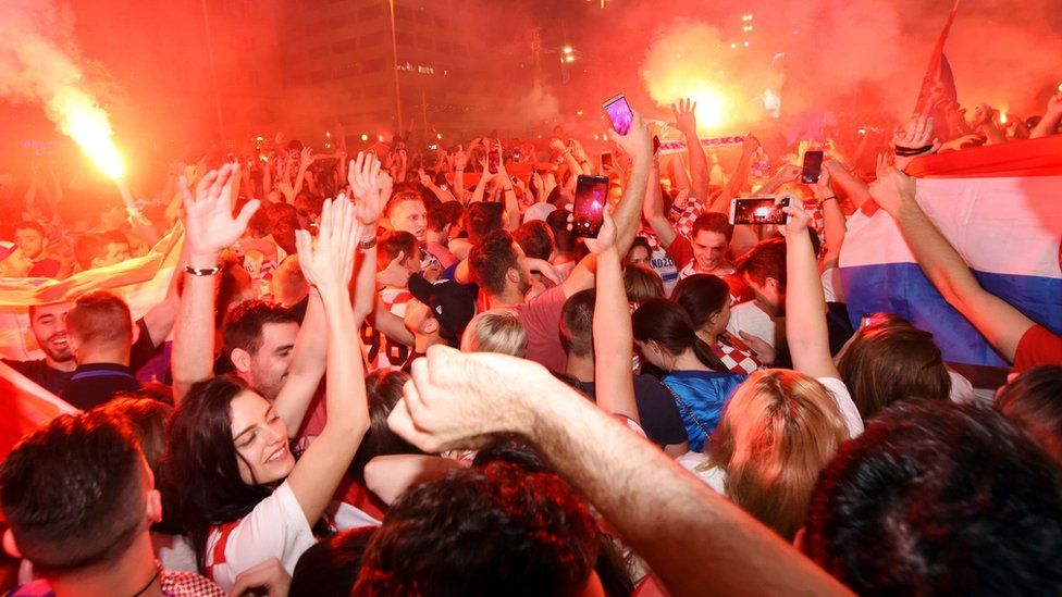 Croatian fans in the capital Zaghreb celebrate their team's victory against Russia in the World cup quarter finals
