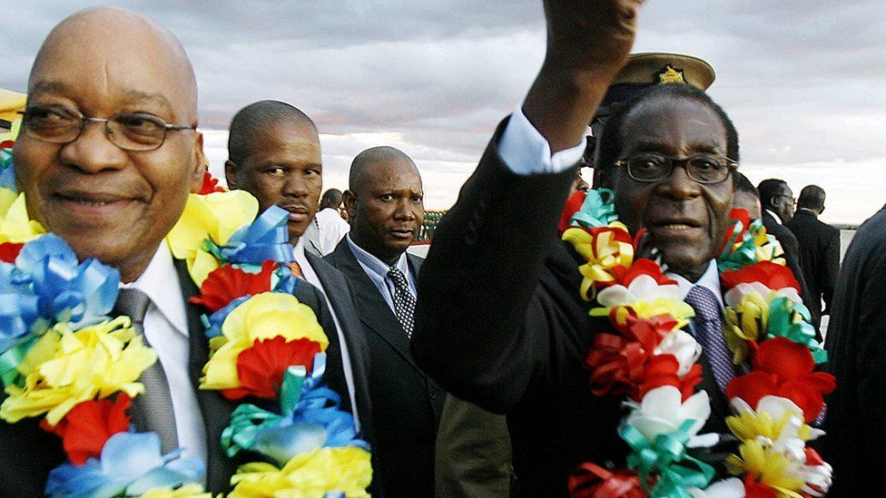 South African President Jacob Zuma (L) and Zimbabwean counterpart Robert Mugabe are seen at Harare International Airport on March 16, 2010.