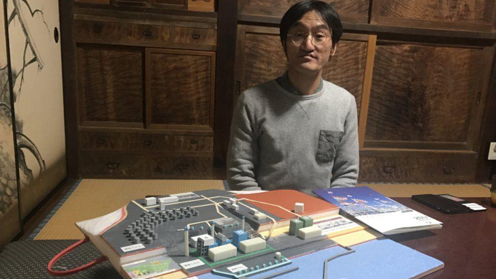 Mr Yoshikawa sits at his home in Futaba town, Japan