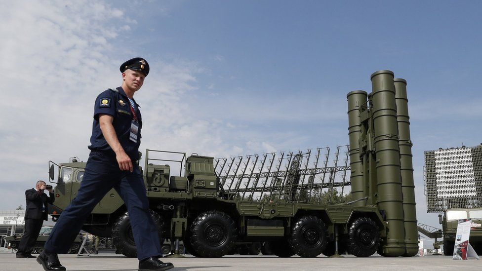 File photo: A Russian military official walks in front of The S-400 Triumph anti-aircraft missile system, 22 August 2017