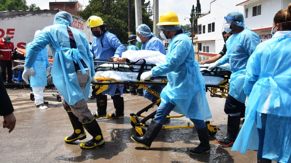 Medical staff move a bed-ridden patient from a hospital in Tula, Hidalgo state, Mexico. Photo: 7 September 2021