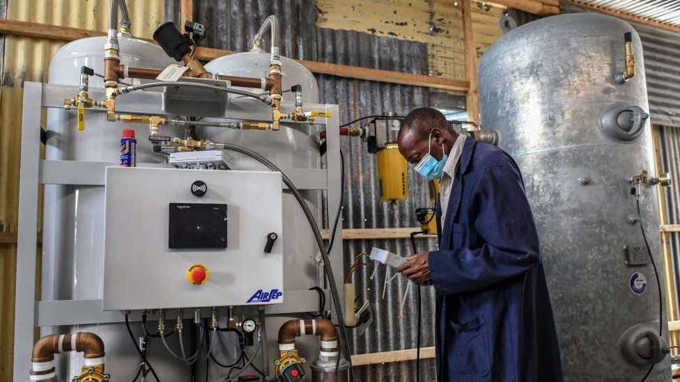 A technician installs the final phase of a domestic oxygen plant at Metropolitan Hospital in Kenya's capital Nairobi on May 2021