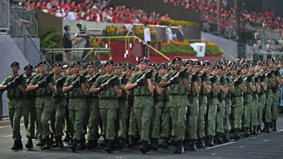 Singapore Armed Forces contingent takes part in a parade during Singapore's 50th National day anniversary celebration