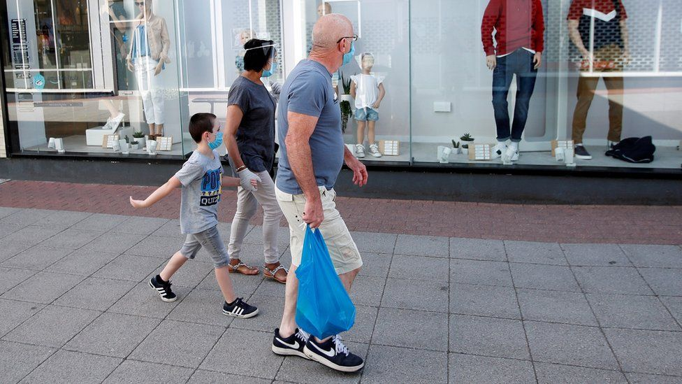 A family wearing facemasks in public