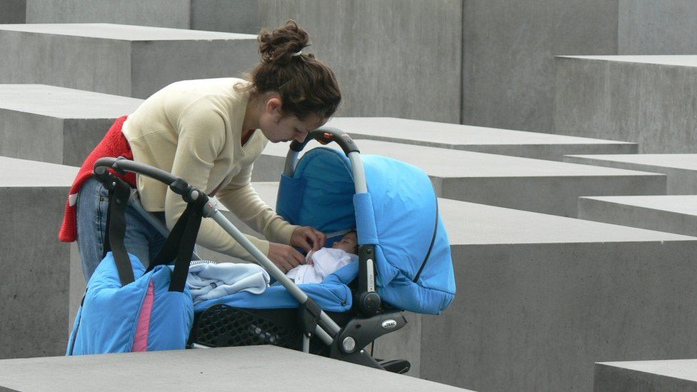 Woman at the Berlin Holocaust memorial