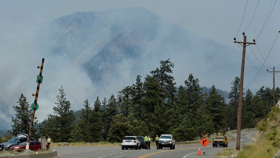 A police blockade outside Lytton, where a wildfire raged through and forced residents to evacuate, July 1, 2021