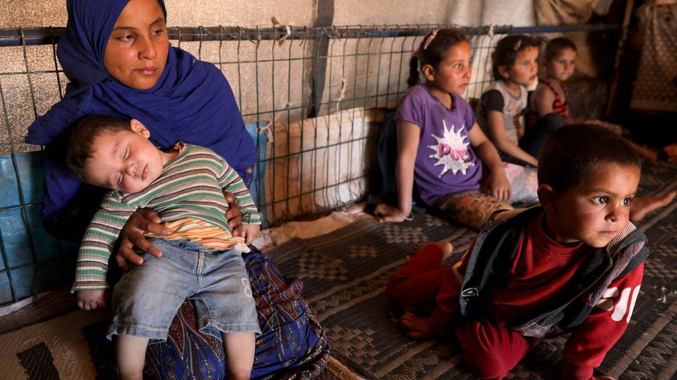 Displaced Syrian children inside their tent at Atmeh camp, near the Turkish border, Syria (13 June 2020)