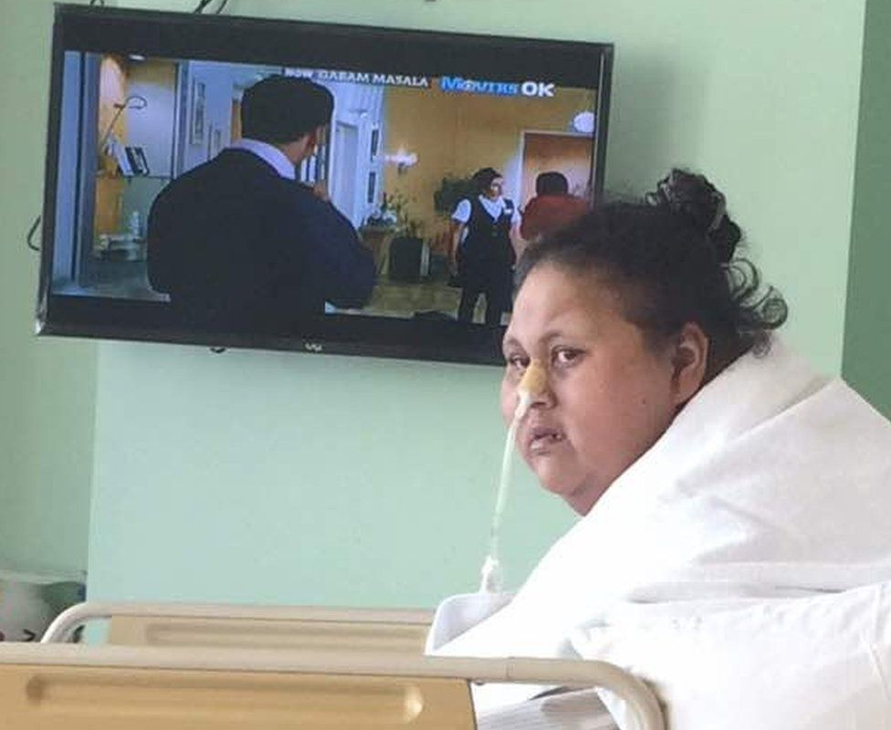 Photo of Eman taken on Monday 24 April 2017 sitting up and watching television