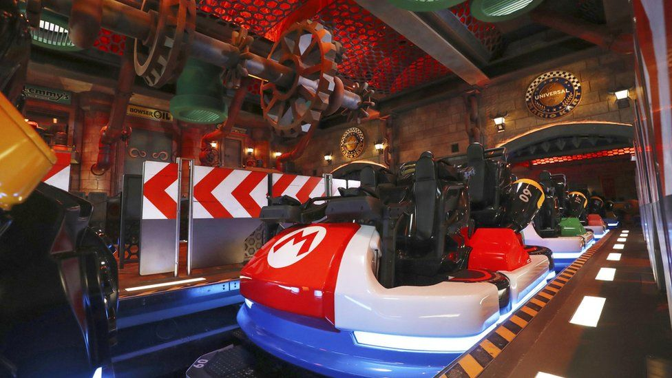 Mario Kart station - a rollercoaster-like boarding area with the carts modelled after Mario Kart go-karts