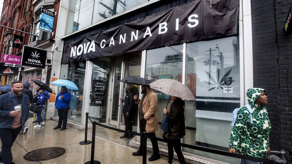 People line up for the opening of a legal cannabis store in Toronto