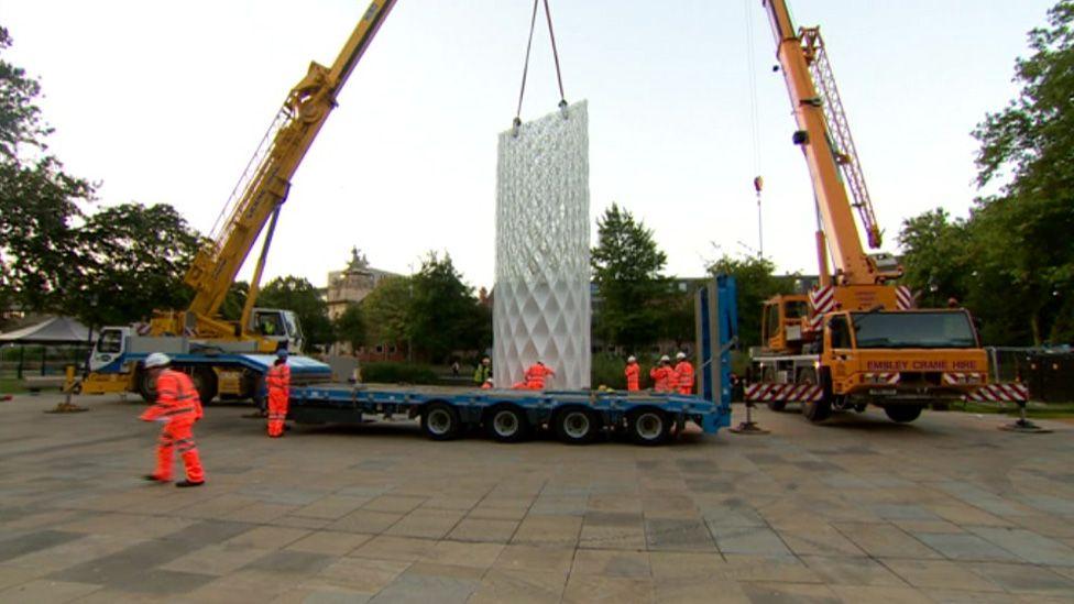 Sculpture being installed