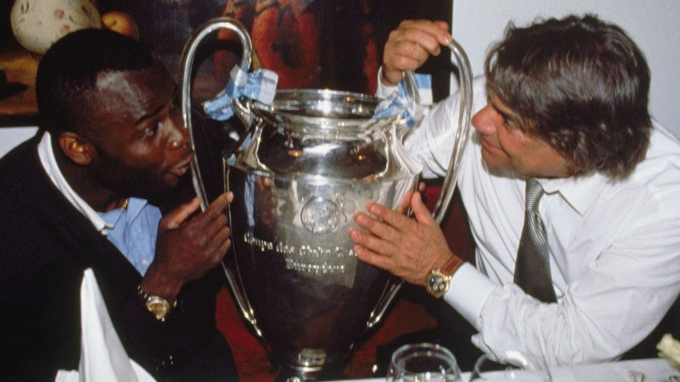 Bernard Tapie and Basile Bodi holding football championship cup