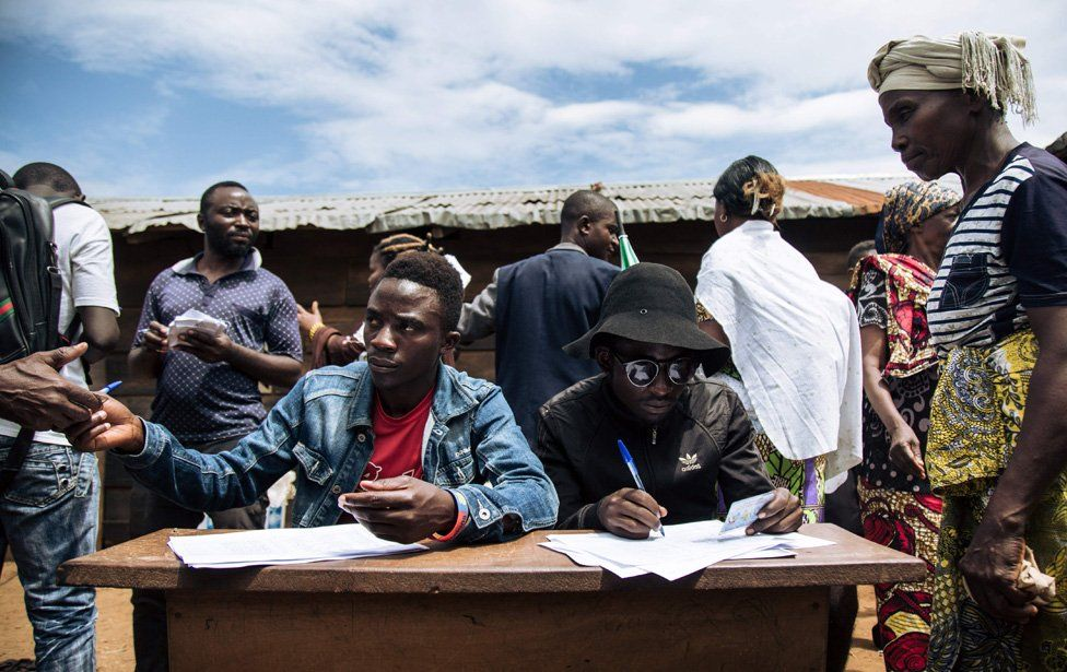 People registering voters in an improvised election in the east of the country