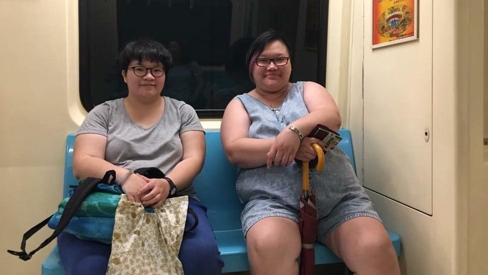 Mallie and Amy on the metro in Taipei