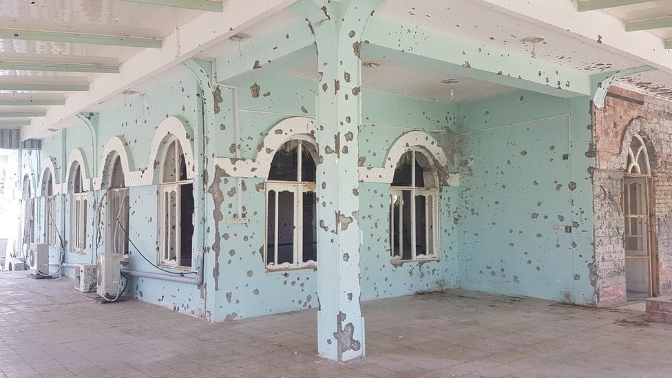 Army base walls pocked with gunshot fire