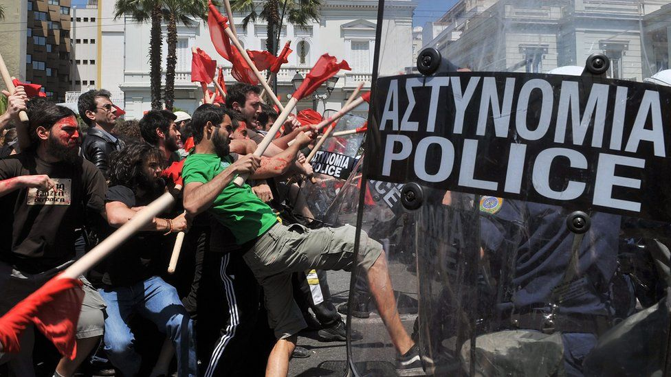 Demonstrators clash with policemen outside the greek Parliament during a Mayday demonstration on May 1, 2010, in Athens.
