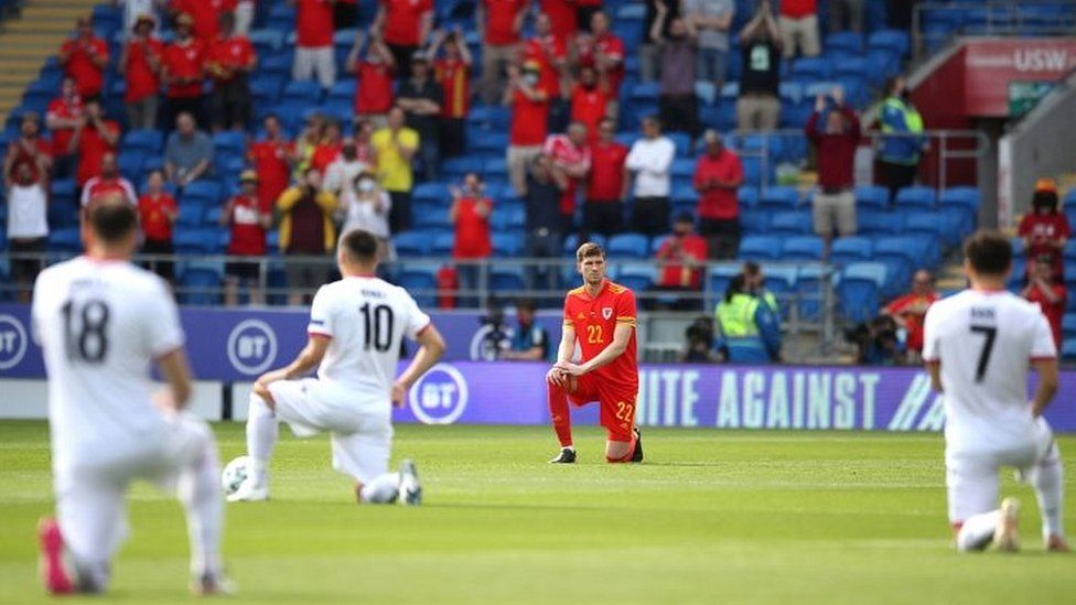 Wales's Chris Mepham takes a knee