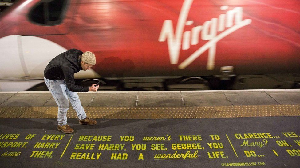 It's A Wonderful Life was painted onto a railway station platform at Glasgow Central