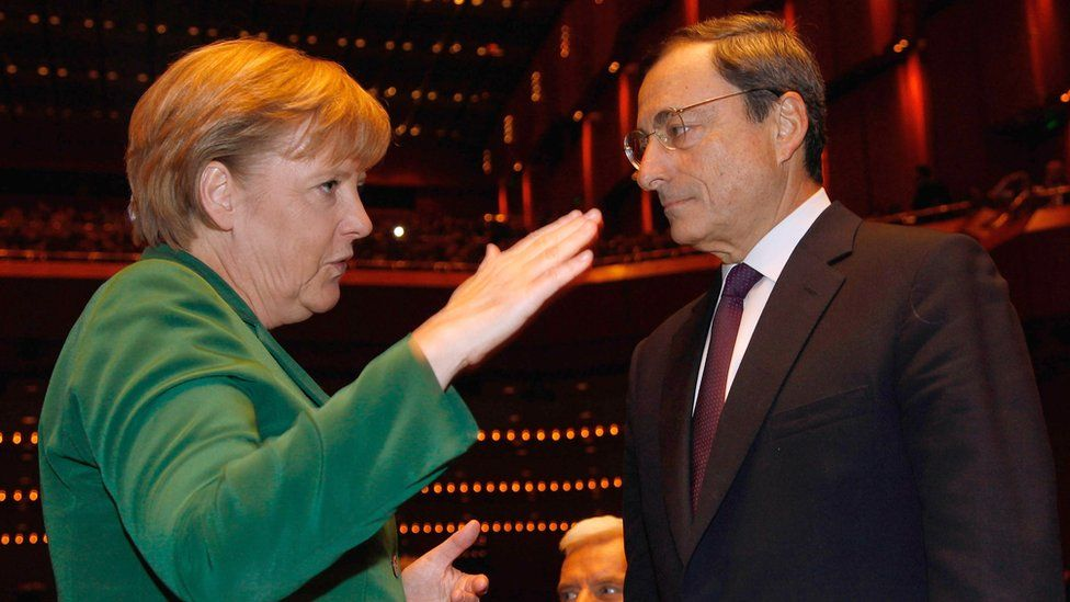 File pic from 2011 of Angela Merkel with Mario Draghi