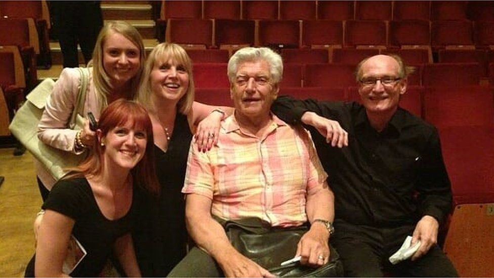 Members of the audience posing with Dave Prowse