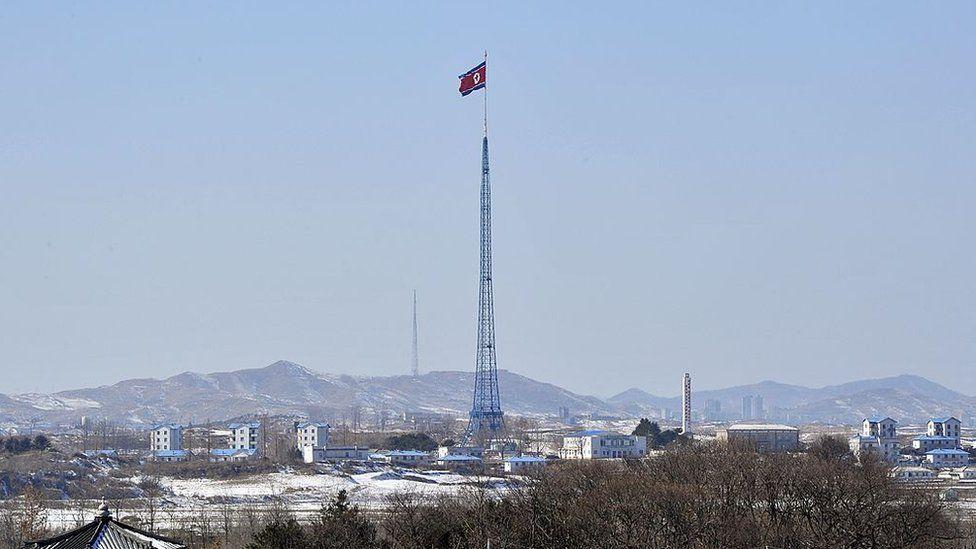 A North Korean flag flutters in the propaganda village of Gijeongdong