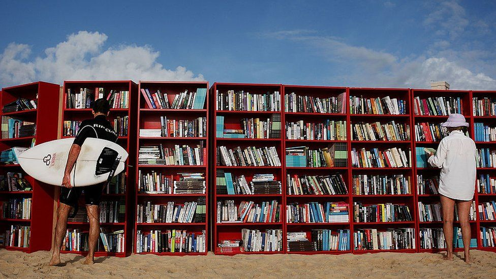 Red Ikea Billy bookcases set up on Australia's Bondi Beach in 2010