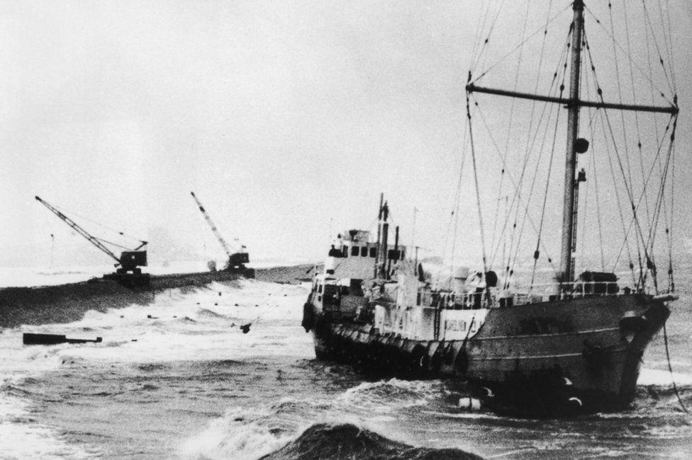 Radio Caroline's pirate radio ship 'MV Mi Amigo' runs aground at Frinton-on-Sea on the Essex coast during a storm, 20th January 1966.