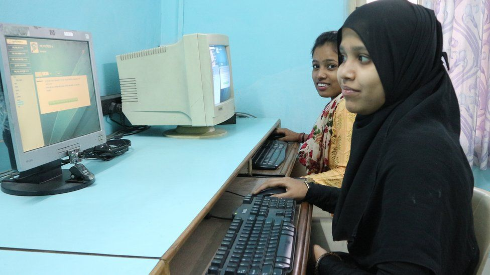 Girls learning how to use computers